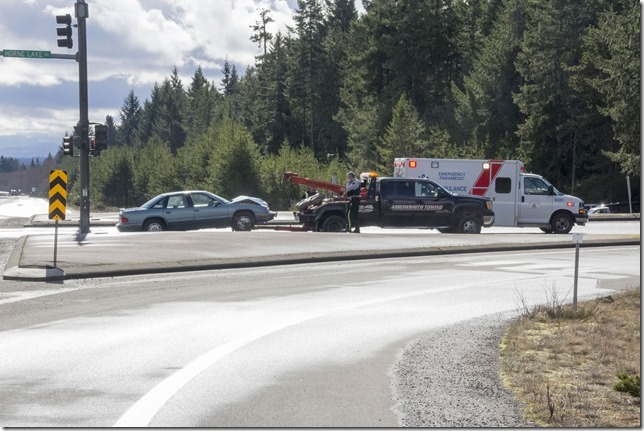emergency vehicles,RCMP,accident,ambulance,Highway 19,Horne Lake Road,tow truck